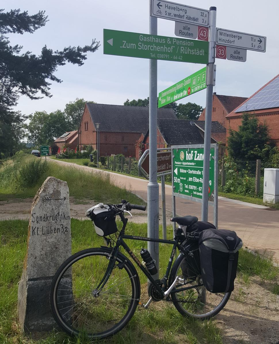 Bike on the side and signpost