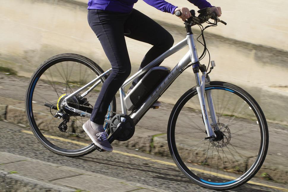 Carrera Crossfire-E Womens Electric Bike - riding 3.jpg