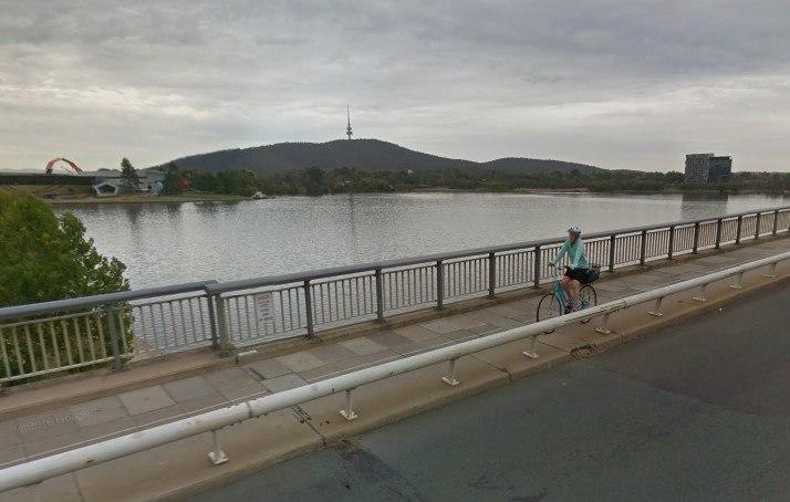 Cyclist on Canberra's Commonwealth Bridge (via StreetView).jpg
