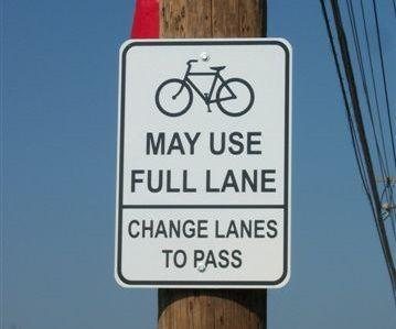 Cyclists may use full lane sign in Ferguson (CC licensed by MoBikeFed via Flickr).jpg