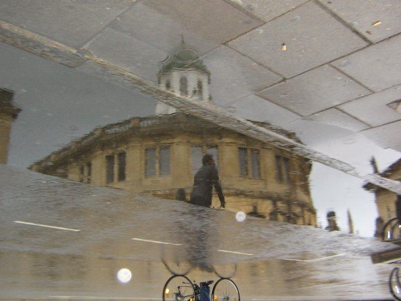 Bike passing Sheldonian Theatre, Oxford.jpg