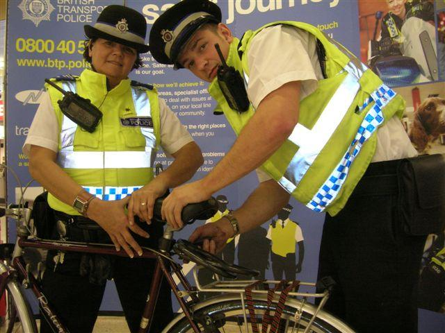 British Transport Police add security tags to a bike.JPG