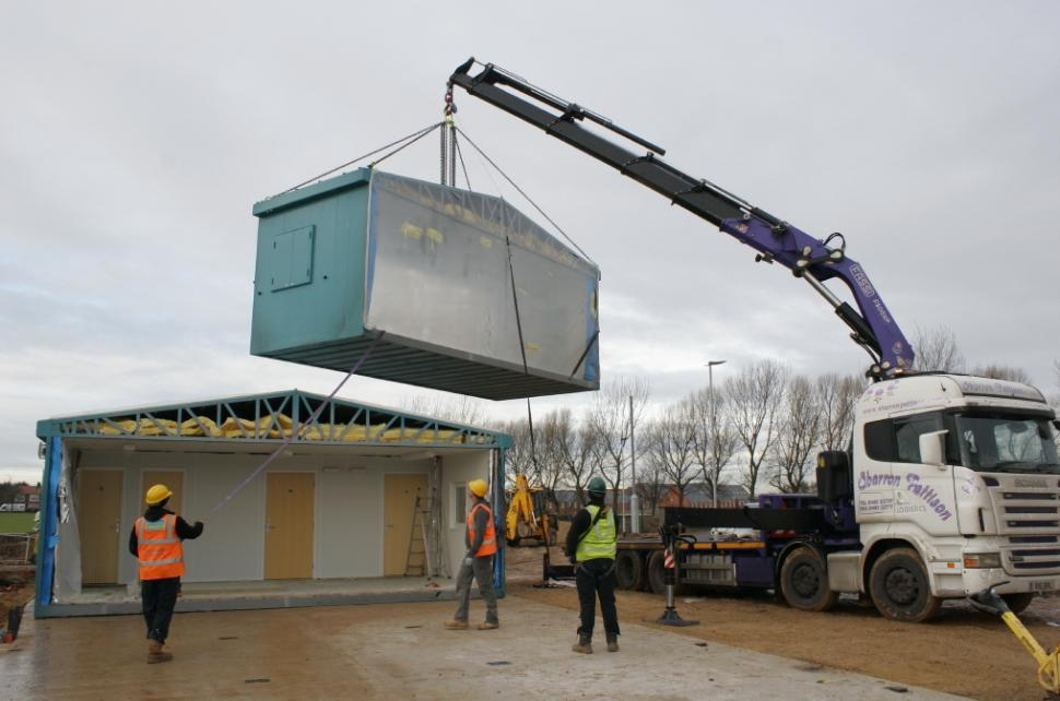 Middlesbrough Cycle Circuit clubhouse is hoisted into place (picture used courtesy of Middlesbrough Council).png