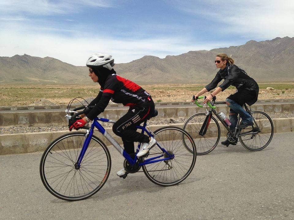 Afghan cyclist rides with M2M founder Shannon Galpin (Photo courtesy of Let Media)