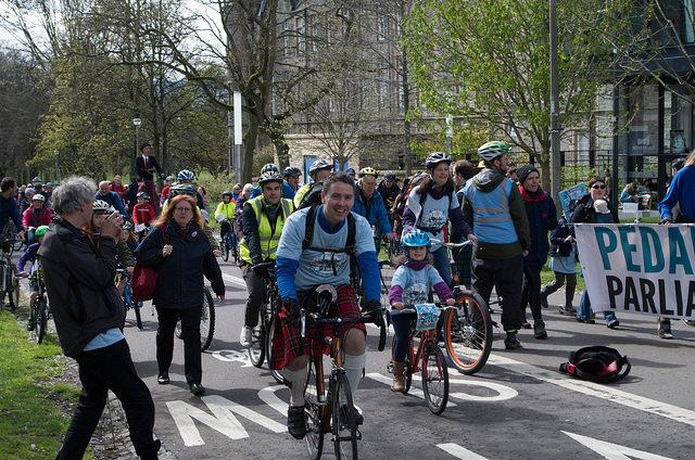 Dave Brennan (centre) at 2015 Pedal on Parliament (licensed by DarkerSide on Flickr under CC-BY-2.0)