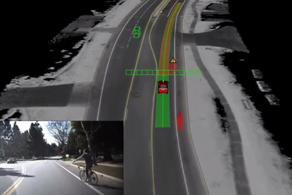 Google driverless car meets cyclist