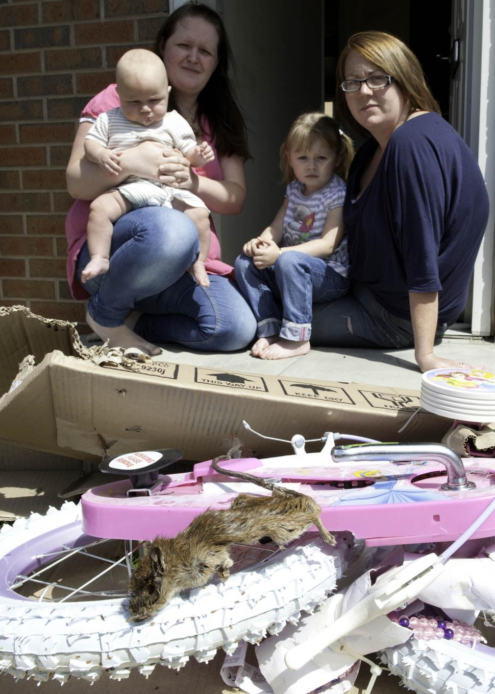Lindsey Rhodes with her son Malakai daughter Mia godmother Lauren Ingle and the decomposed rat found dead in the packaging pic courtesy The Star.JPG