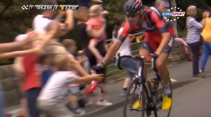 Marcus Burghradt gives his musette to a young fan