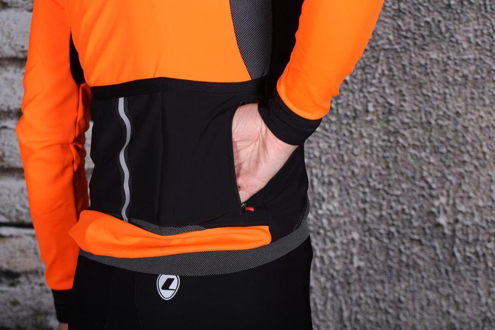 Lusso Aqua Extreme Repel Jacket - pocket zipped.jpg