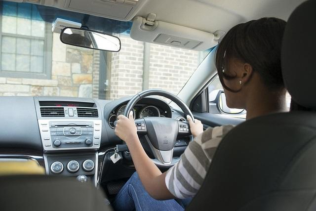 Young driver (licensed CC BY 2.0 by State Farm on Flickr).jpg