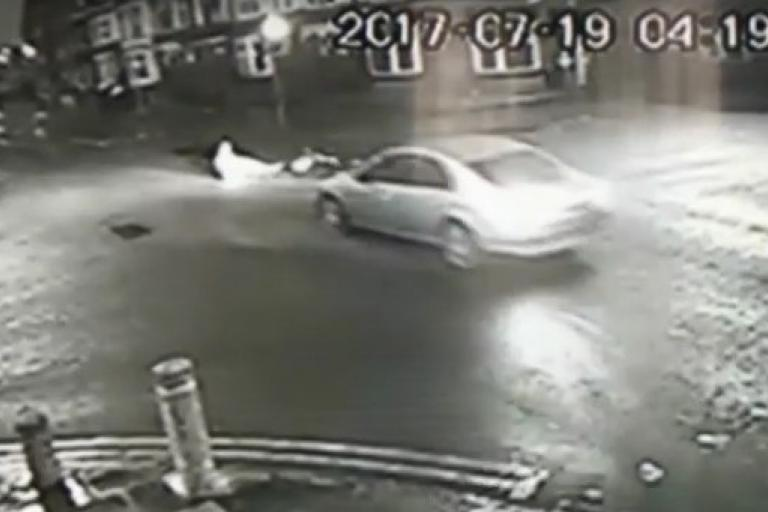 Car reverses away from cyclist (via BBC).jpg