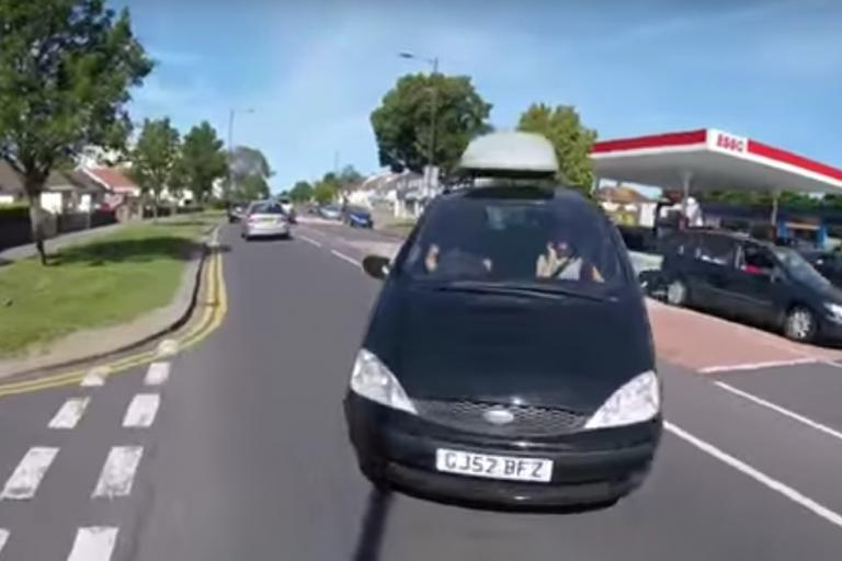 Car turning into cyclist's path (YouTube).jpg