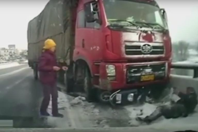 Cyclist hit by truck in China (taken from YouTube).jpg