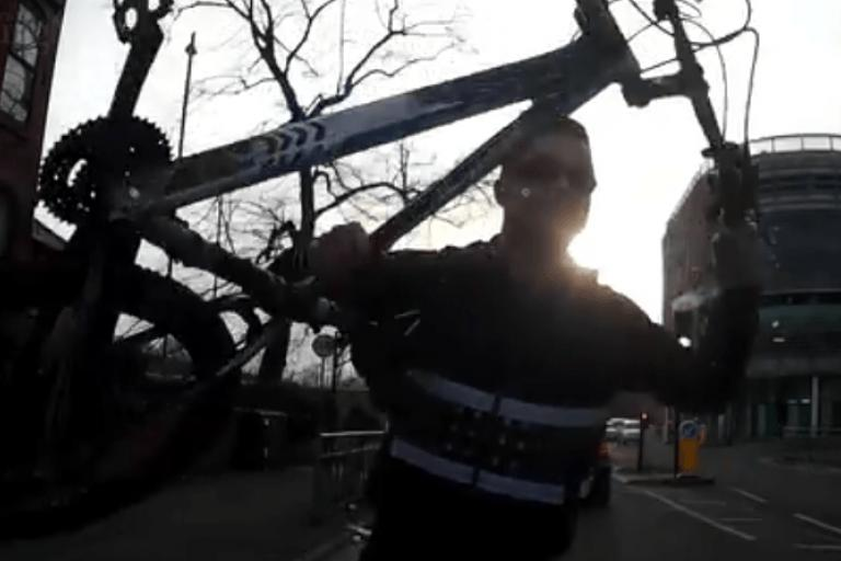 Cyclist smashes car windscreen dash-cam footage still.PNG