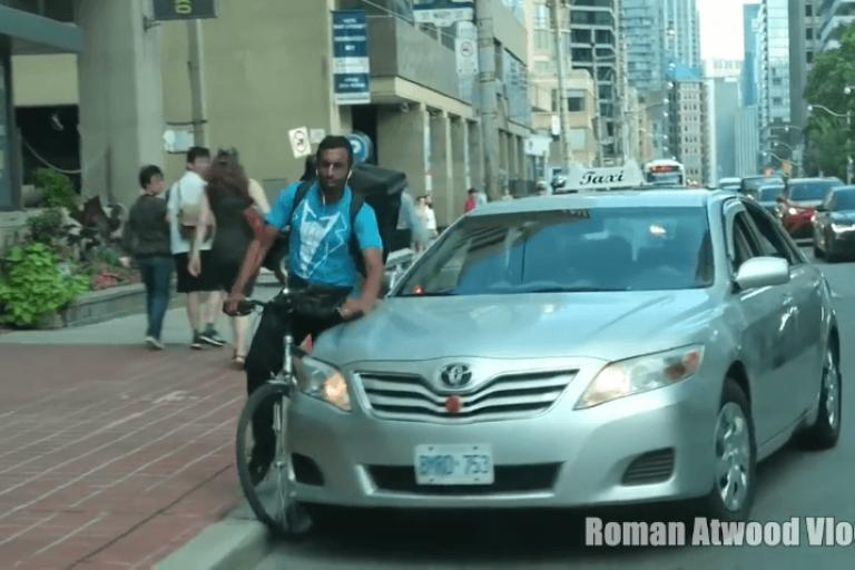 Cyclist taken out by Toronto taxi driver - image via YO Q YouTube channel.PNG