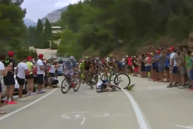 Fan takes out rider at Vuelta.PNG
