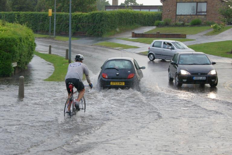 Flooded cyclist - image CC licenced via Chris Sampson on Flickr.jpg
