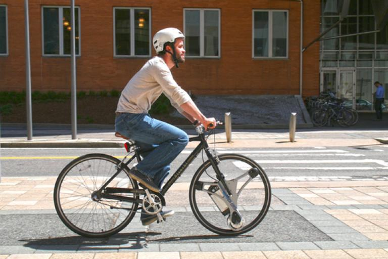 GeoOrbital CTO Dakota Decker using company's electric front wheel (source Kickstarter).png