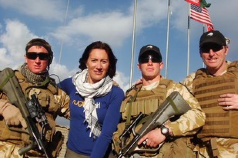 Kylie Phaup-Stephens with NZ troops in Afghanistan.jpeg