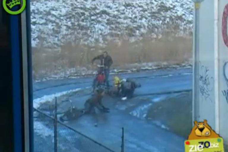 Dutch cyclists slipping on icy corner