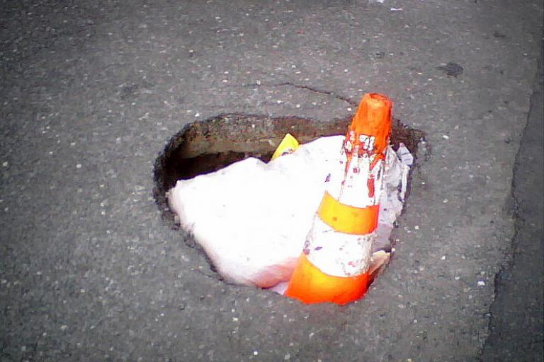 A pothole yesterday - Image by dasmart via Flickr