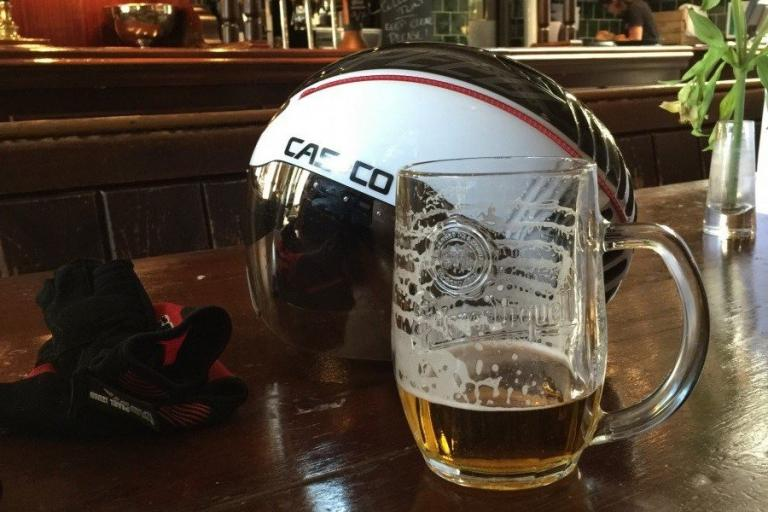 Beer and a helmet - image via Judge dreadful on roadcc