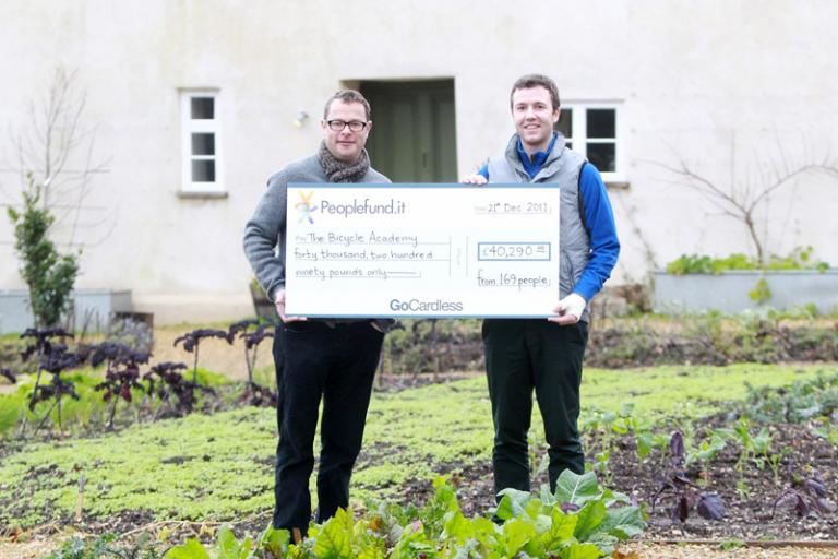 Bicycle-Academy-Andrew-Denham-receives-cheque-from-peoplefund.it-Hugh-Fearnley-Whittingstall