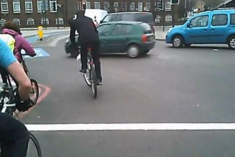 Bow Roundabout green car jumps red light (user kmcyc YouTube still)