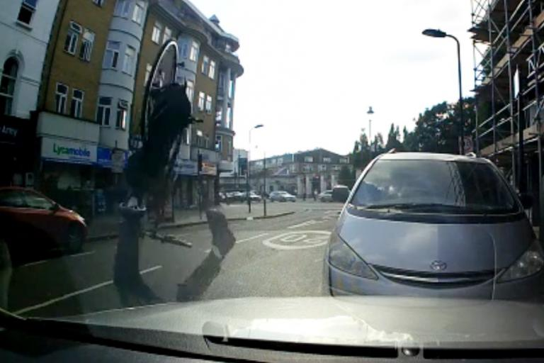 Cyclist somersaults after hitting pothole (still taken from London Evening Standard video)