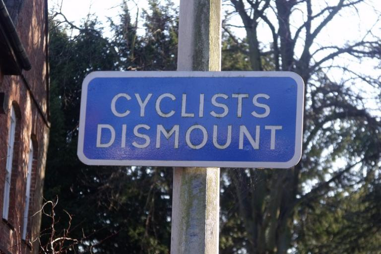 Cyclists Dismount (via Flickr user Elliott Brown)