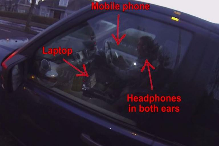 Driver on mobile phone, laptop and wearing headphones (Aberdeen Cycle Cam YouTube still)