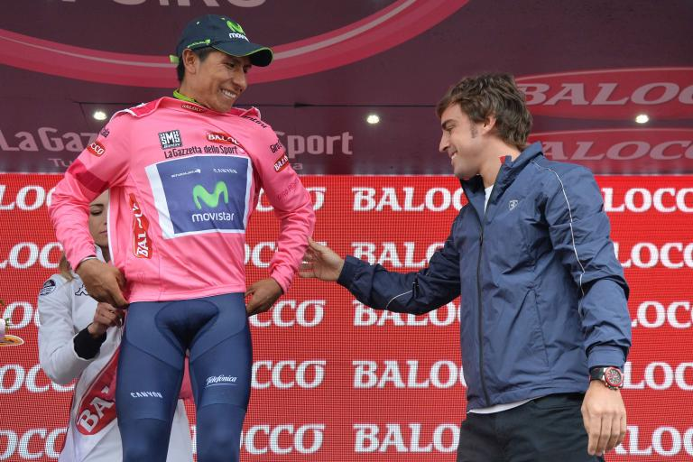 Fernando Alonso presents Nairo Quintana with maglia rosa at S18 of 2014 Giro (pic credit Gian Mattia d'Alberto, LaPresse)