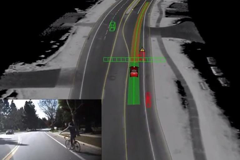 Google driverless car meets cyclist
