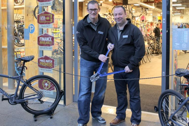 Halfords CEO Matt Davies (left, at the opening of the first Cycle Republic store) is to join Tesco and UK and Ireland CEO