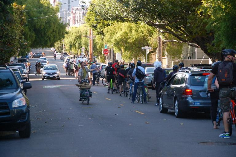 San Francisco bike commuters queued up for over a block to make a full stop at Steiner and Waller Streets. Photo Aaron Bialick