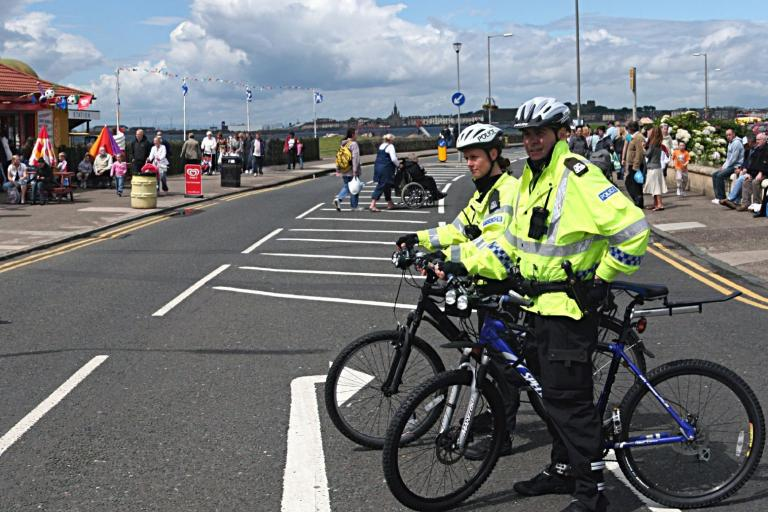 Scottish police on bikes (copyright g_cowan via Flickr)