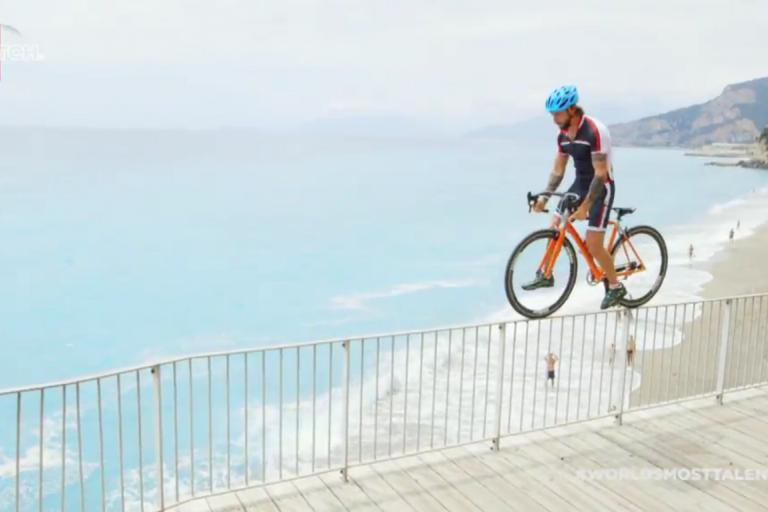 Vittorio Brumotti cycles across a railing - image via WATCH Youtube account