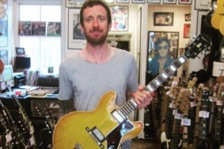 Sir Bradley Wiggins poses with one of his guitars (picture New Kings Road Vintage Guitar Emporium on Facebook)