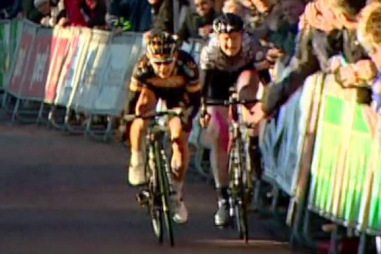 Spectator grabs Loren Rowney's bike (source RTV Drentse video screenshot)