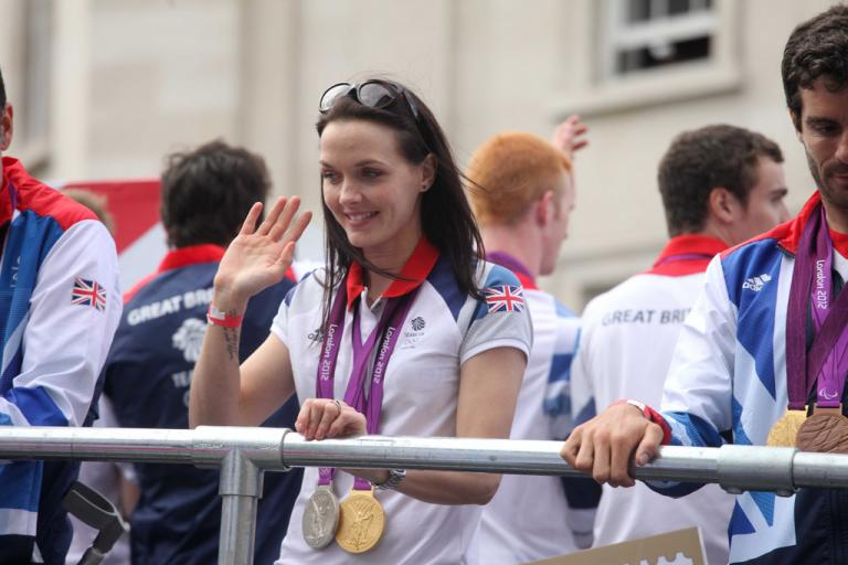 Victoria Pendleton waves from the Olympic parade bus (Image CC licensed DCMS:Flickr)