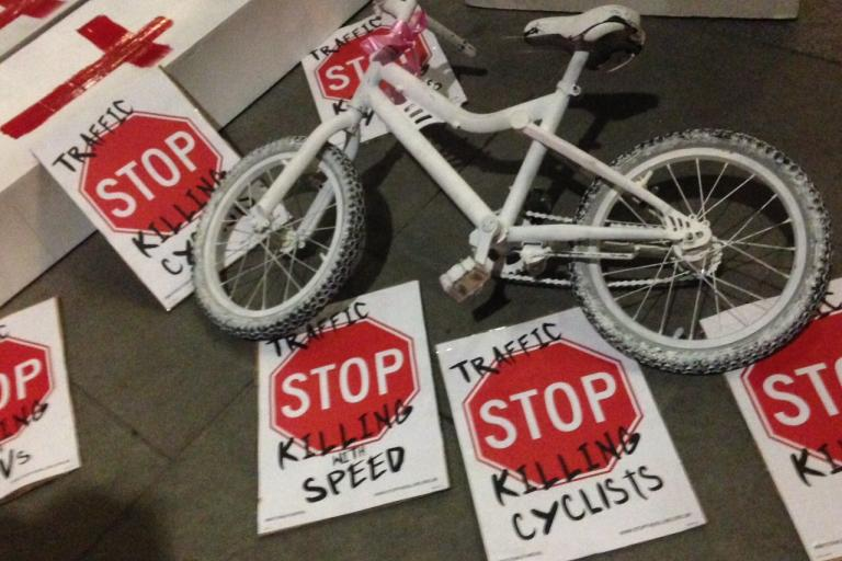 White bike with placards