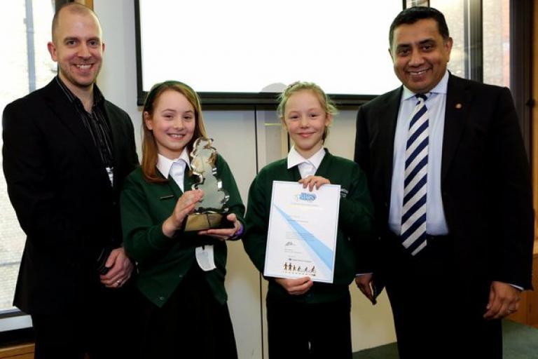 Lord Ahmad presenting Rawdon Littlemoor Primary School with National STARS award.jpg