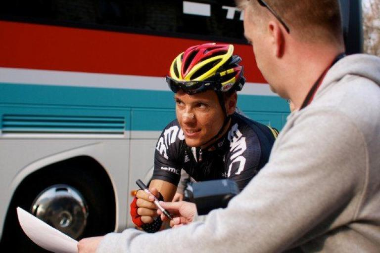 Philippe Gilbert with pen in hand (copyright Simon MacMichael).jpg