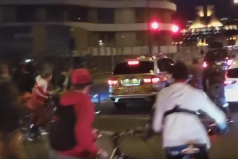 Police car hits cyclist.png