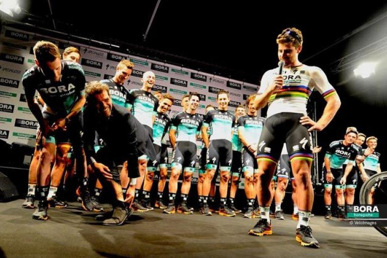 Ralph Denk shows off his Peter Sagan tattoo (via Bora-Hansgrohe).PNG