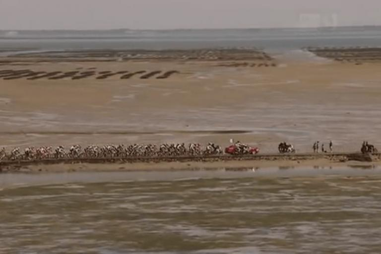 Tour de France 2011 crosses the Passage du Gois (TV video still).PNG